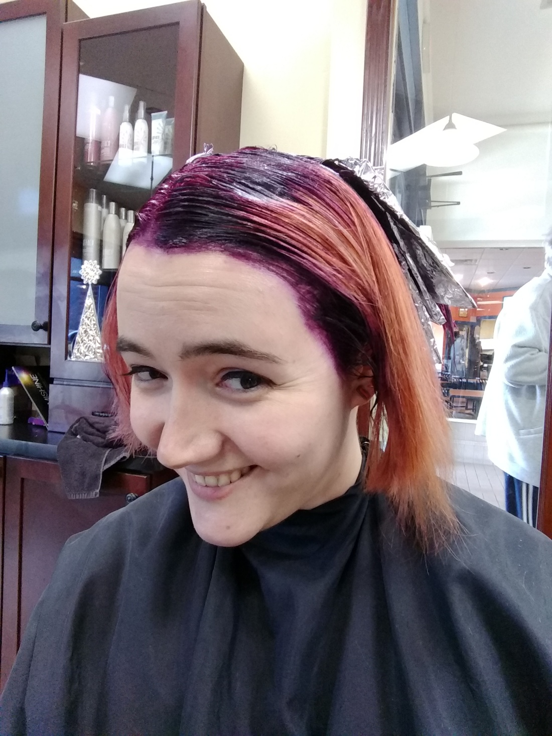The purple root color being applied and foils for the highlights in the back of my head.