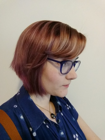 Faded purple hair, side view.